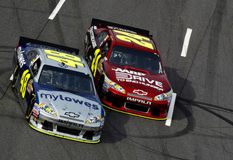 MARTINSVILLE, VA - APRIL 01:  Jimmie Johnson, driver of the #48 MyLowe's Chevrolet, races Jeff Gordon, driver of the #24 Drive to End Hunger Chevrolet, into turn one during the NASCAR Sprint Cup Series Goody's Fast Relief 500 at Martinsville Speedway on A