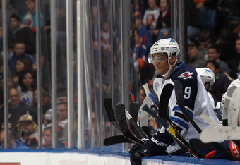 UNIONDALE, NY - APRIL 05:  Evander Kane #9 of the Winnipeg Jets watches the game against the New York Islanders from the bench at the Nassau Veterans Memorial Coliseum on April 5, 2012 in Uniondale, New York. The Islanders defeated the Jets 5-4.  (Photo b