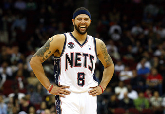 NEWARK, NJ - MARCH 19:  Deron Williams #8 of the New Jersey Nets laughs on court against the Cleveland Cavaliers at Prudential Center on March 19, 2012 in Newark, New Jersey.  NOTE TO USER: User expressly acknowledges and agrees that, by downloading and o