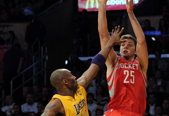LOS ANGELES, CA - APRIL 06:  Chandler Parsons #25 of the HOston Rockets shoots a  three pointer in front of Kobe Bryant #24 of the Los Angeles Lakers during a 112-107 Rocket win at Staples Center on April 6, 2012 in Los Angeles, California.  NOTE TO USER:
