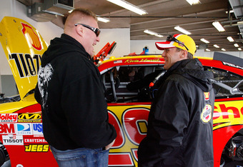 DAYTONA BEACH, FL - FEBRUARY 13:  MMA fighter Brock Lesnar speaks with Kevin Harvick, driver of the #29 Shell/Pennzoil Chevrolet, during practice for the Daytona 500 at Daytona International Speedway on February 13, 2010 in Daytona Beach, Florida.  (Photo