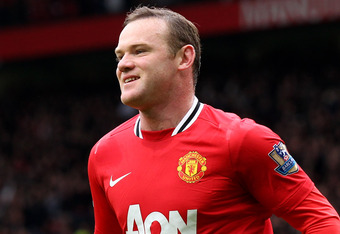 MANCHESTER, ENGLAND - APRIL 08:  Wayne Rooney of Manchester United reacts after scoring the opening goal from the penalty spot during the Barclays Premier League match between Manchester United and Queens Park Rangers at Old Trafford on April 8, 2012 in M