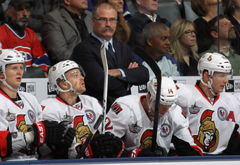 TORONTO, ON - NOVEMBER 12:  Head coach Paul MacLean of the Ottawa Senators coaches his team against the Toronto Maple Leafs at the Air Canada Centre on November 12, 2011 in Toronto, Ontario, Canada. The Senators defeated the Maple Leafs 5-2.  (Photo by Br