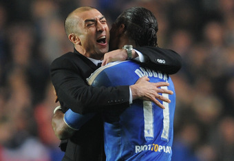 LONDON, ENGLAND - MARCH 14:  Roberto Di Matteo caretaker manager of Chelsea celebrates victory with Didier Drogba after the UEFA Champions League Round of 16 second leg match between Chelsea FC and SSC Napoli at Stamford Bridge on March 14, 2012 in London
