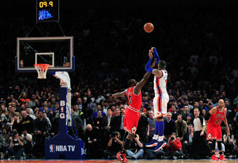NEW YORK, NY - APRIL 08:  Carmelo Anthony #7 of the New York Knicks shoots the game winning three pointer over Luol Deng #9 of the Chicago Bulls at Madison Square Garden on April 8, 2012 in New York City. NOTE TO USER: User expressly acknowledges and agre