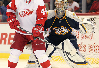 DETROIT,MI - OCTOBER 30:  Todd Bertuzzi #44 of the Detroit Red Wings waits to tip a shot in front of Pekke Rinne #35 of the Nashville Predators in a game on October 30,2010 at the Joe Louis Arena in Detroit , Michigan. The Wings defeated the Predators 5-2