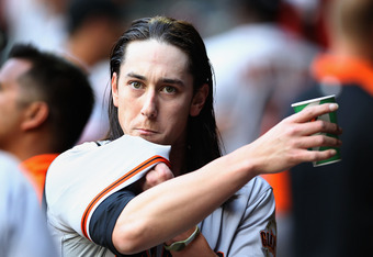 PHOENIX, AZ - APRIL 06:  Starting pitcher Tim Lincecum #55 of the San Francisco Giants in the dugout during the Opening Day game against the Arizona Diamondbacks at Chase Field on April 6, 2012 in Phoenix, Arizona.  The Diamondbacks defeated the Giants 5-