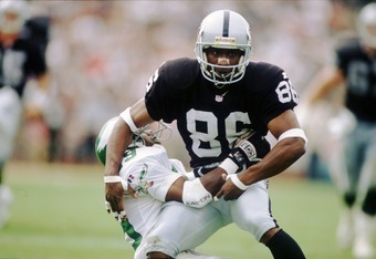 24 SEP 1995:  WIDE RECEIVER RAGHIB 'ROCKET' ISMAIL OF THE OAKLAND BATTLES A PHILADELPHIA EAGLES DEFENDER DURING THE RAIDER''S 48-17 WIN AT THE OAKLAND COLISEUM IN OAKLAND, CALIFORNIA. Mandatory Credit: Al Bello/ALLSPORT