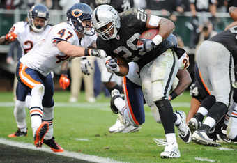 OAKLAND, CA - NOVEMBER 27:  Michael Bush #29 of the Oakland Raiders beats Chris Conte #47 of the Chicago Bears to the goal line for a three yard touchdown run in the fourth quarter at O.co Coliseum on November 27, 2011 in Oakland, California.  (Photo by T