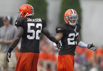 BEREA, OH - AUGUST 04:  Joe Haden #23 of the Cleveland Browns slaps hands with teammate D'Qwell Jackson #52 during training camp at the Cleveland Browns Training and Administrative Complex on August 4, 2010 in Berea, Ohio.  (Photo by Gregory Shamus/Getty