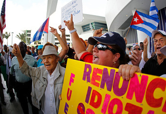 MIAMI, FL - APRIL 10:  Protesters rally outside a press conference held by Manager Ozzie Guillen for comments made about Fidel Castro at Marlins Park on April 10, 2012 in Miami, Florida. The Marlins suspended Guillen for five games over his pro-Castro com