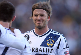 CARSON, CA - MARCH 18:  David Beckham #23 of the Los Angeles Galaxy makes a face at teammate Robbie Keane #7 after Keane scored his second goal of the match against D.C. United in the second half during the MLS match at The Home Depot Center on March 18,