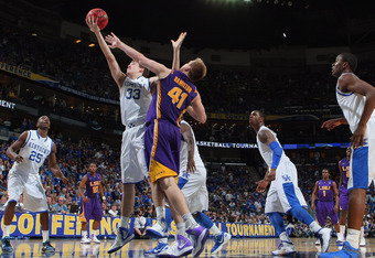 NEW ORLEANS, LA - MARCH 09:  Kyle Wiltjer #33 of the Kentucky Wildcats makes a shot over Justin Hamilton #41 of the LSU Tigers during the quarterfinals of the SEC Men's Basketball Tournament at the New Orleans Arena on March 9, 2012 in New Orleans, Louisi