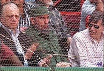 Angelos, Castro, and Selig take in a game in 1999.