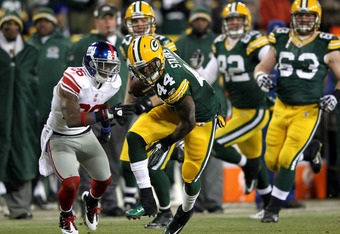 GREEN BAY, WI - JANUARY 15:  James Starks #44 of the Green Bay Packers runs with the ball against the New York Giants during their NFC Divisional playoff game at Lambeau Field on January 15, 2012 in Green Bay, Wisconsin.  (Photo by Jamie Squire/Getty Imag