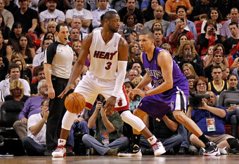 MIAMI, FL - FEBRUARY 21:  Dwyane Wade #3 of the Miami Heat posts up Francisco Garcia #32 of the Sacramento Kings at American Airlines Arena on February 21, 2012 in Miami, Florida. NOTE TO USER: User expressly acknowledges and agrees that, by downloading a