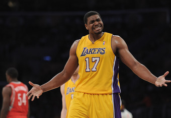 LOS ANGELES, CA - APRIL 06:  Andrew Bynum #17 of the Los Angeles Lakers reacts for a foul call against the Houston Rockets at Staples Center on April 6, 2012 in Los Angeles, California.  NOTE TO USER: User expressly acknowledges and agrees that, by downlo