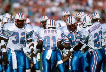 SAN FRANCISCO - NOVEMBER 8:  Wide receiver Ernest Givens #81 of the Houston Oilers high fives teammates Alonzo Highsmith #32 and Keith Bostic #25 during a game against the San Francisco 49ers at Candlestick Park on November 8, 1987 in San Francisco, Calif