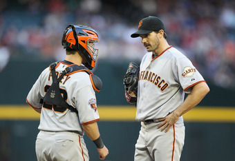 PHOENIX, AZ - APRIL 16:  Catcher Buster Posey #28 and starting pitcher Barry Zito #75 of the San Francisco Giants talk during the Major League Baseball game against the Arizona Diamondbacks at Chase Field on April 16, 2011 in Phoenix, Arizona.  The Giants