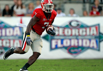 JACKSONVILLE, FL - OCTOBER 30:  Orson Charles #7 of the Georgia Bulldogs runs for yardage during the game against the Florida Gators at EverBank Field on October 30, 2010 in Jacksonville, Florida.  (Photo by Sam Greenwood/Getty Images)