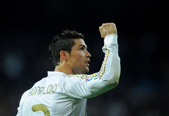 MADRID, SPAIN - MARCH 24:  Cristiano Ronaldo of Real Madrid CF celebrates after scoring his team's second goal during the La iga match between Real Madrid CF and Real Sociedad de Futbol at Estadio Santiago Bernabeu on March 24, 2012 in Madrid, Spain.  (Ph