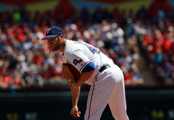 ARLINGTON, TX - APRIL 06:  Colby Lewis #48 of the Texas Rangers at Rangers Ballpark in Arlington on April 6, 2012 in Arlington, Texas.  (Photo by Ronald Martinez/Getty Images)