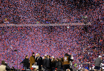 FOXBORO, MA - JANUARY 22:  The New England Patriots celebrates with the Lamar Hunt Trophy after their AFC Championship Game at Gillette Stadium on January 22, 2012 in Foxboro, Massachusetts. The New England Patriots defeated the Baltimore Ravens 20-23.  (
