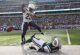 EAST RUTHERFORD, NJ - OCTOBER 23: Santonio Holmes #10 of the New York Jets has a pass broken up by Quentin Jammer #23 of the San Diego Chargers at MetLife Stadium on October 23, 2011 in East Rutherford, New Jersey.  (Photo by Nick Laham/Getty Images)