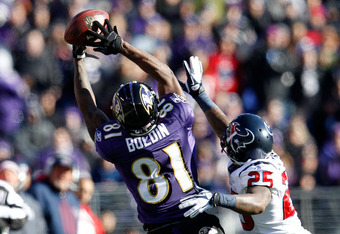 BALTIMORE, MD - JANUARY 15:  Anquan Boldin #81 of the Baltimore Ravens catches a pass against Kareem Jackson #25 of the Houston Texans during the AFC Divisional playoff game at M&T Bank Stadium on January 15, 2012 in Baltimore, Maryland. Baltimore won 20-