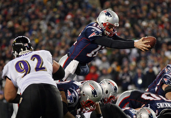 FOXBORO, MA - JANUARY 22:  Tom Brady #12 of the New England Patriots dives into the end zone to score a touchdown in the fourth quarter against the Baltimore Ravens during their AFC Championship Game at Gillette Stadium on January 22, 2012 in Foxboro, Mas