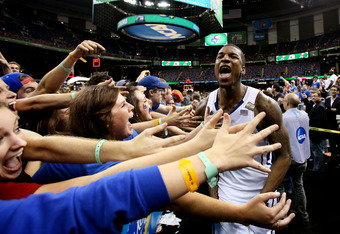 NEW ORLEANS, LA - MARCH 31:  Thomas Robinson #0 of the Kansas Jayhawks celebrates with the fans after the Jayhawks defeat the Ohio State Buckeyes 64-62 during the National Semifinal game of the 2012 NCAA Division I Men's Basketball Championship at the Mer