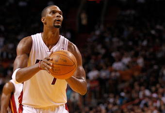 MIAMI, FL - FEBRUARY 21:  Chris Bosh #1 of the Miami Heat shoots a free throw during a game  against the Sacramento Kings at American Airlines Arena on February 21, 2012 in Miami, Florida. NOTE TO USER: User expressly acknowledges and agrees that, by down