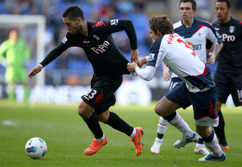 BOLTON, ENGLAND - APRIL 07:  Clint Dempsey of Fulham in action with Marcos Alonso of Bolton Wanderers during the Barclays Premier League match between Bolton Wanderers and Fulham at Reebok Stadium on April 7, 2012 in Bolton, England.  (Photo by Clive Brun