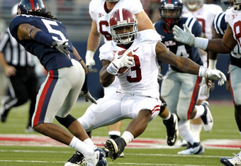 OXFORD, MS - OCTOBER 15:  Running back Trent Richardson #3 of the Alabama Crimson Tide jukes past safety Frank Crawford #5 of the Ole Miss Rebels for a big run in the second quarter on October 15, 2011 at Vaught-Hemingway Stadium in Oxford, Mississippi. (