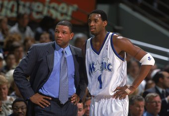 How would the fates of Tracy McGrady and Doc Rivers been altered by the presence of Tim Duncan?