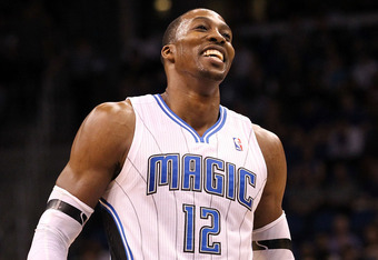 ORLANDO, FL - MARCH 13:  Dwight Howard #12 of the Orlando Magic smiles during the game against the Miami Heat at Amway Center on March 13, 2012 in Orlando, Florida.  NOTE TO USER: User expressly acknowledges and agrees that, by downloading and or using th