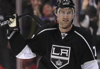 LOS ANGELES, CA - MARCH 22:  Jeff Carter #77 of the Los Angeles Kings celebrates after scoring what turned out to be the winning shootout goal against the St. Louis Blues at Staples Center on March 22, 2012 in Los Angeles, California.  The Kings won 1-0 i