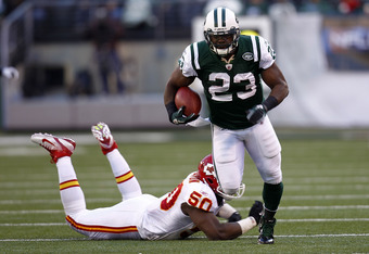 EAST RUTHERFORD, NJ - DECEMBER 11:  Shonn Greene #23 of the New York Jets runs away from  Justin Houston #50 of the Kansas City Chiefs during their game at MetLife Stadium on December 11, 2011 in East Rutherford, New Jersey.  (Photo by Jeff Zelevansky/Get