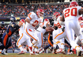 DENVER, CO - JANUARY 1: Kyle Orton #8 looks to hand the ball off to Thomas Jones #20 of the Kansas City Chiefs during the game against the Denver Broncos at Sports Authority Field at Mile High on January 1, 2012 in Denver, Colorado.  (Photo by Garrett W.
