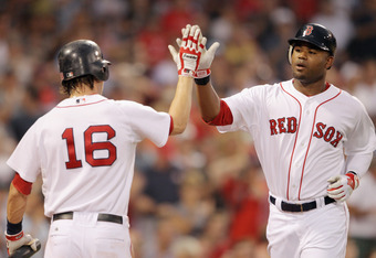 BOSTON, MA - AUGUST 01:  Carl Crawford #13 is congratulated by teammate Josh Reddick #16 of the Boston Red Sox after Crawford hit a solo home run in the third inning against the Cleveland Indians on August 1, 2011 at Fenway Park in Boston, Massachusetts.