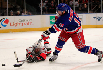 NEW YORK - OCTOBER 29: Brad Richards #19 of the New York Rangers shoots past Chris Phillips #4 of the Ottawa Senators at Madison Square Garden on October 29, 2011 in New York City.  (Photo by Chris Trotman/Getty Images)