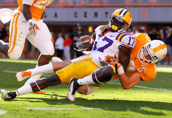 KNOXVILLE, TN - OCTOBER 15:  Morris Claiborne #17 of the LSU Tigers is tackled by Zach Rogers #83 of the Tennessee Volunteers after returning an interception in the first quarter at Neyland Stadium on October 15, 2011 in Knoxville, Tennessee.  (Photo by K