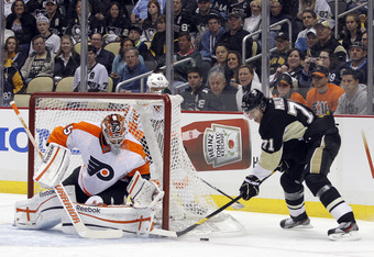 PITTSBURGH, PA - APRIL 7:  Evgeni Malkin #71 of the Pittsburgh Penguins attempts a wrap around against Sergei Bobrovsky #35 of the Philadelphia Flyers during the game at Consol Energy Center on April 7, 2012 in Pittsburgh, Pennsylvania.  (Photo by Justin