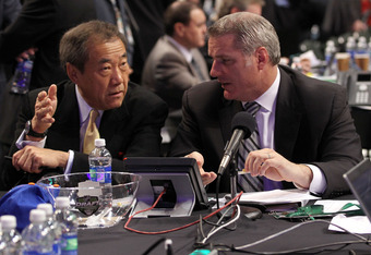 ST PAUL, MN - JUNE 24:  Owner Charles Wang and Garth Snow General Manager of the New York Islanders during day one of the 2011 NHL Entry Draft at Xcel Energy Center on June 24, 2011 in St Paul, Minnesota.  (Photo by Bruce Bennett/Getty Images)