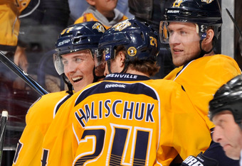 NASHVILLE, TN - APRIL 11:  Gabriel Bourque #57, Matt Halischuk #24, and Nick Spaling #13 of the Nashville Predators celebrate a goal against the Detroit Red Wings in Game One of the Western Conference Quarterfinals during the 2012 NHL Stanley Cup Playoffs