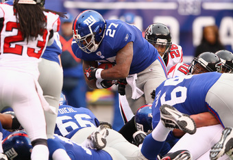EAST RUTHERFORD, NJ - JANUARY 08:  Brandon Jacobs #27 of the New York Giants runs for a first down on a 4th and 1-yard play late in the second quarter against the Atlanta Falcons during their NFC Wild Card Playoff game at MetLife Stadium on January 8, 201