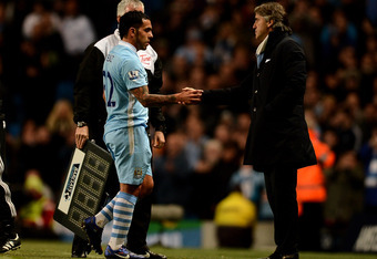 Carlos Tevez and Roberto Mancini at the West Brom game: a fallen star forgiven.