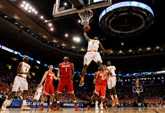 BOSTON, MA - MARCH 24:  Dion Waiters #3 of the Syracuse Orange goes to the hoop against Sam Thompson #12 and Deshaun Thomas #1 of the Ohio State Buckeyes during the 2012 NCAA Men's Basketball East Regional Final at TD Garden on March 24, 2012 in Boston, M