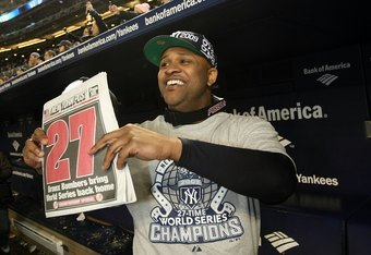 NEW YORK - NOVEMBER 04:  C.C. Sabathia of the New York Yankees celebrates in the dugout with a copy of the New York Post after their 7-3 win against the Philadelphia Phillies in Game Six of the 2009 MLB World Series at Yankee Stadium on November 4, 2009 i