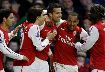 WOLVERHAMPTON, ENGLAND - APRIL 11:  Robin van Persie of Arsenal celebrates after scoring their first goal from the penalty spot during the Barclays Premier League match between Wolverhampton Wanderers and Arsenal at Molineux on April 11, 2012 in Wolverham